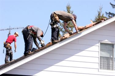 Roof Installation in South Pasadena CA. Three roofers laying new shingle on a roof in South Pasadena.
