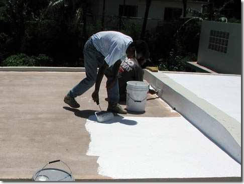 Roofer applying roof coating in South Pasadena, CA